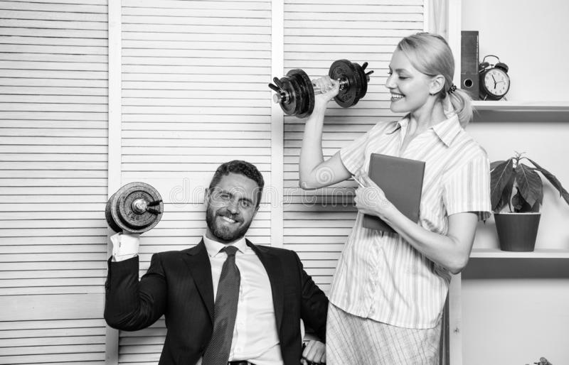 Man and woman raise heavy dumbbells. Strong powerful business strategy. Good job concept. Boss businessman and office. Man and women raise heavy dumbbells royalty free stock photography
