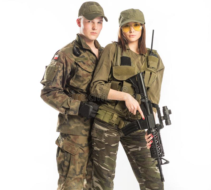 Man and woman in soldier`s suit on white background. Man and women in soldier`s suit on white background royalty free stock images