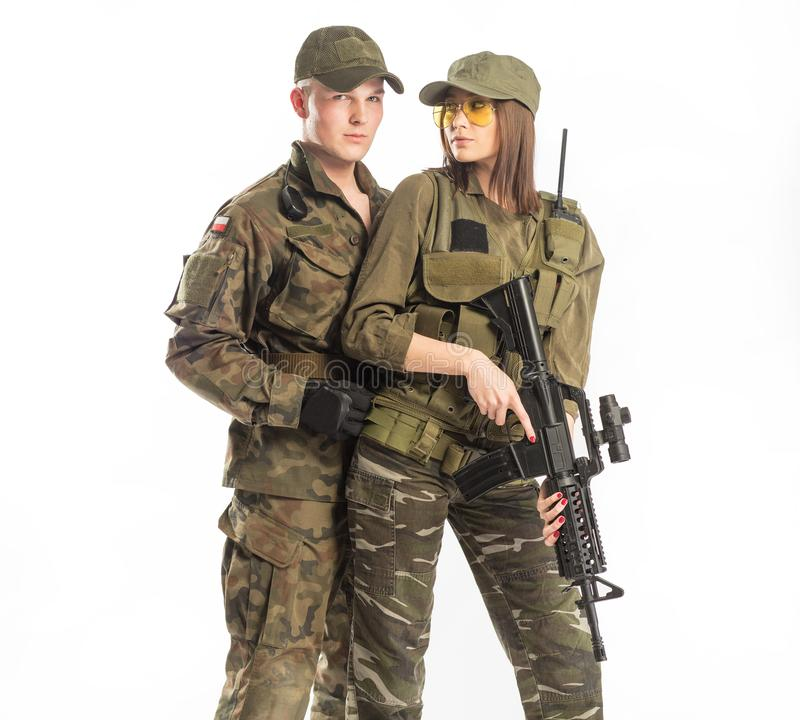 Man and woman in soldier`s suit on white background. royalty free stock photography