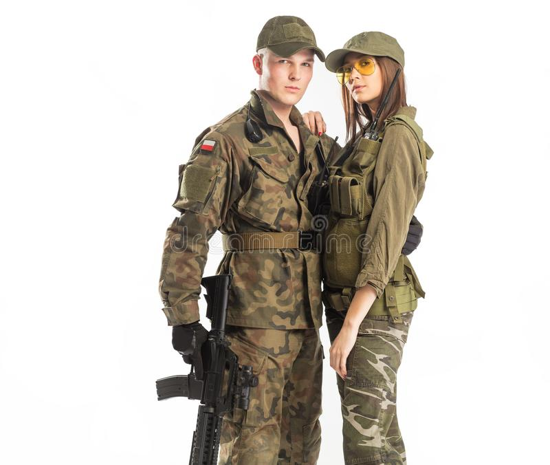 Man and woman in soldier`s suit on white background royalty free stock photo