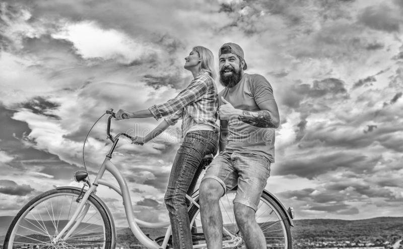 Man and woman spend active leisure with bike. Couple in love date outdoors cycling. Bike rental or bike hire for short royalty free stock photography