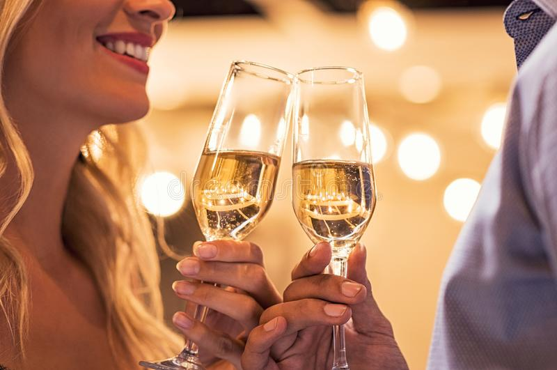 Couple toasting campagne flutes royalty free stock photography