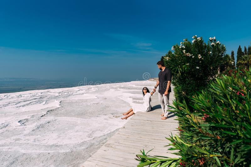 Man and woman traveling. Couple in love walking. Couple in Pamukkale. Travelling to Turkey. Lover. Honeymoon trip stock photography