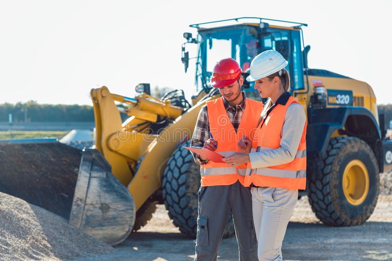 Man and woman worker on construction site stock images
