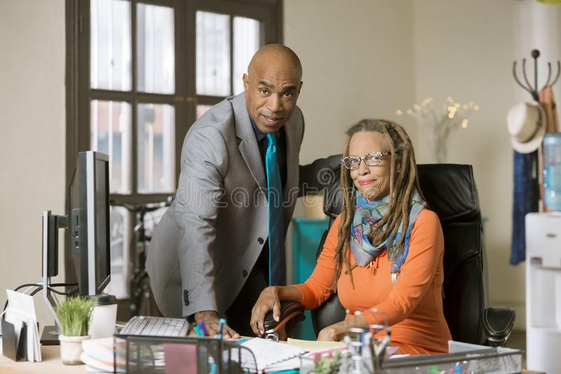 Man and Woman Working in a Creative Office stock image