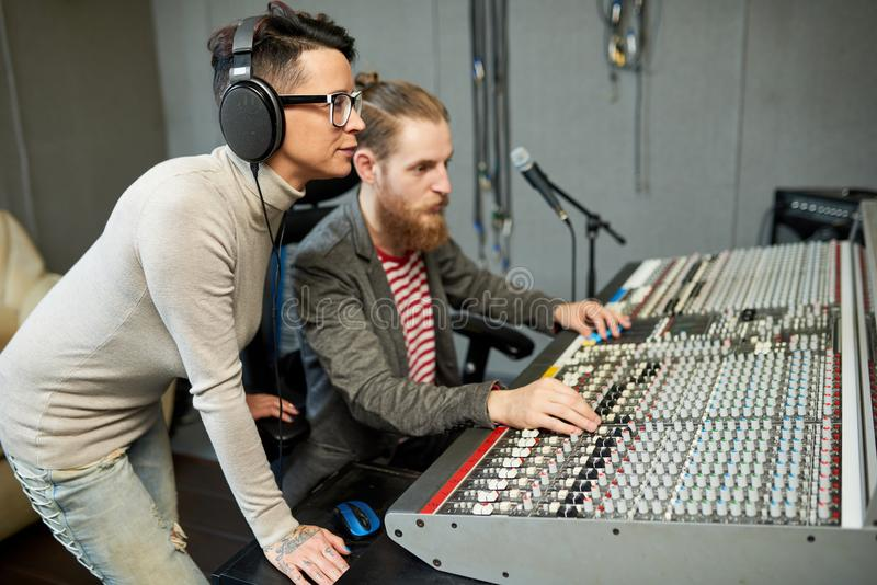Coworkers in process of creating music royalty free stock photo