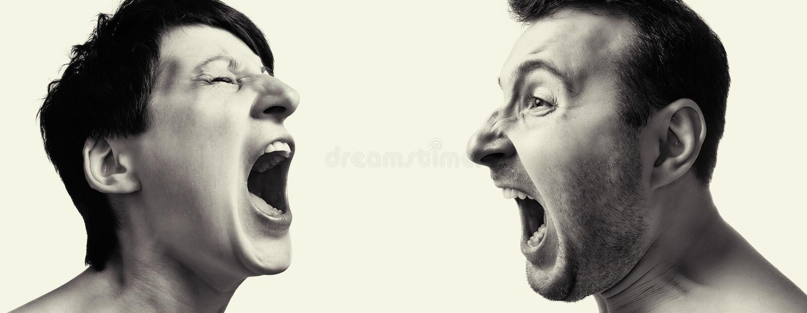 Man and woman yell at each other stock images