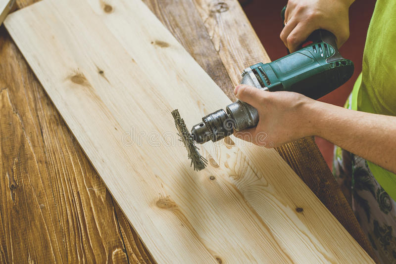 Man wood brashing. With drill machine royalty free stock images