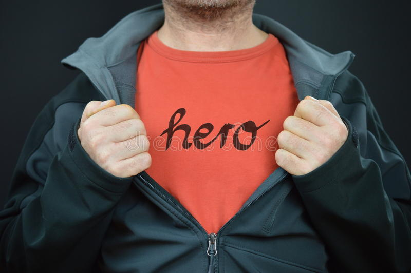 A man with the word hero on his t-shirt stock photos