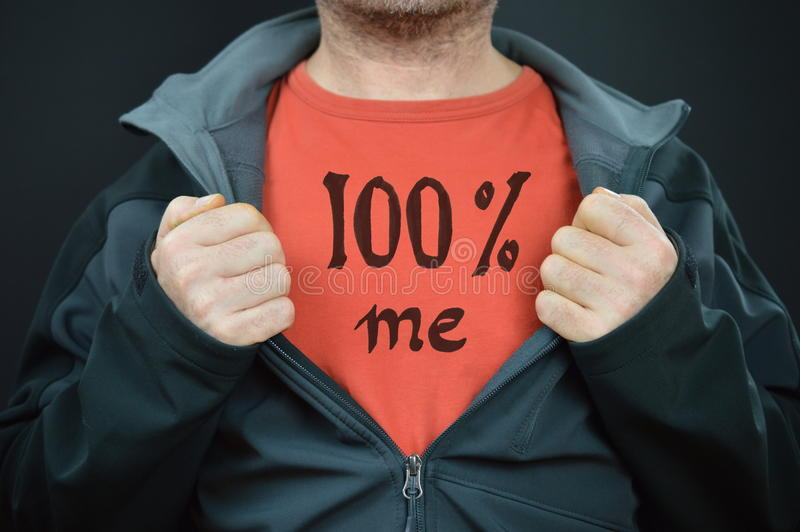 A man with the words 100% me on his red t-shirt stock photography