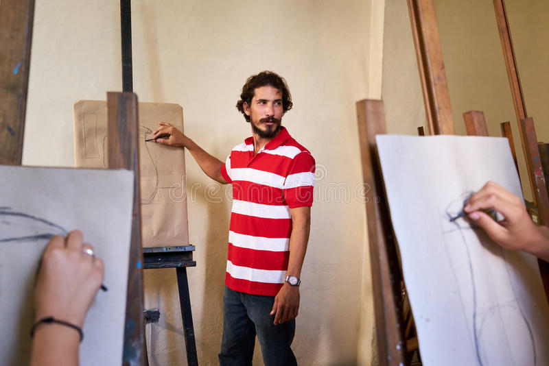 Man At Work As Teacher In Art School With Students royalty free stock images
