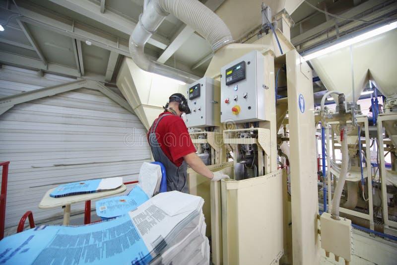 Man work at Caparol factory stock photo