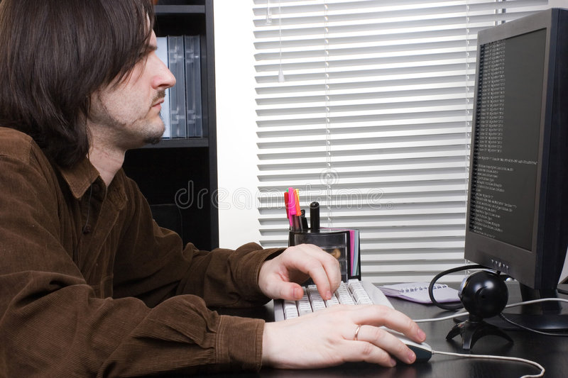 Man work with comp. In office royalty free stock photo