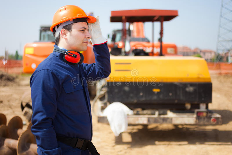 Man at work in a construction site royalty free stock image
