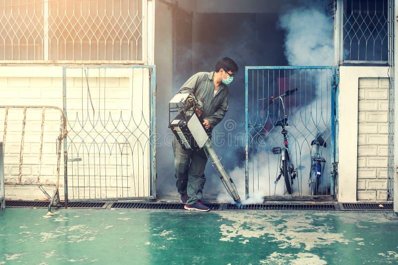 Man work fogging to eliminate mosquito and zika virus stock image