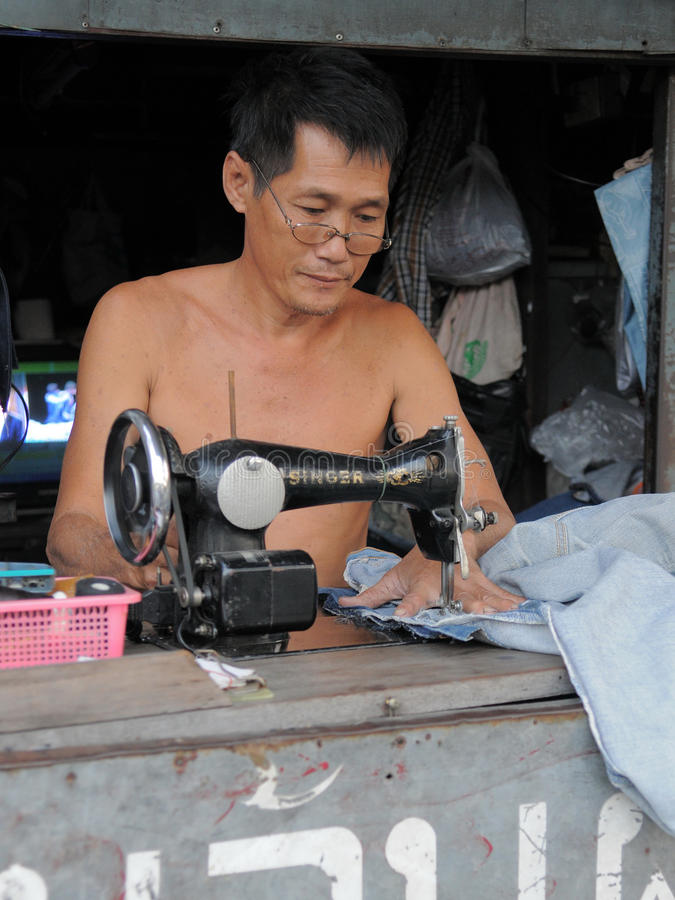 Man at Work in a Garments Shop royalty free stock photo