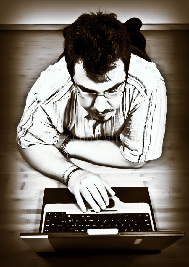 Man work with his laptop stock images