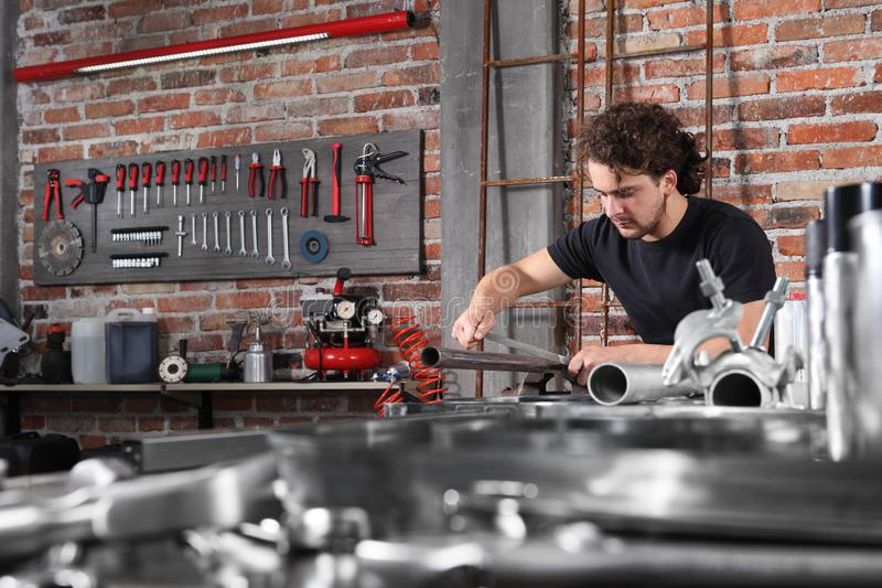 Man Work In Home Workshop Garage With Steel File Rasp Filing Metal Pipe On The Workbench Full Of Wrenches Diy And Craft Concept Stock Photo Image Of Hand Concept 162317428