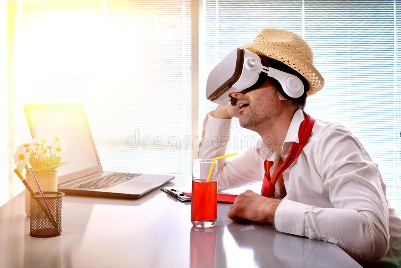 Man at work imagining his vacation with vr glasses royalty free stock photos
