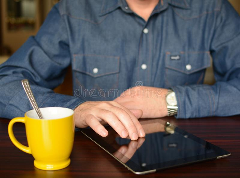 Man on work. Man working on tablet stock image
