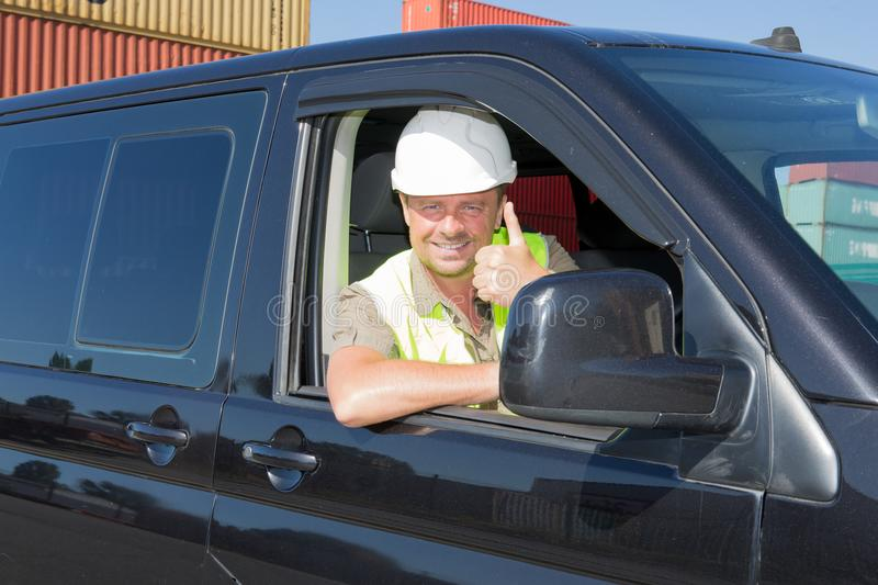 man worker with his helmet and yellow safety vest thumbs up royalty free stock photos