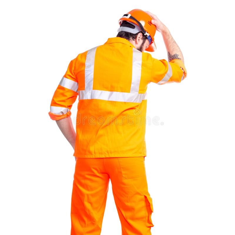 Man worker road constructor looking, hands on head helmet royalty free stock photos
