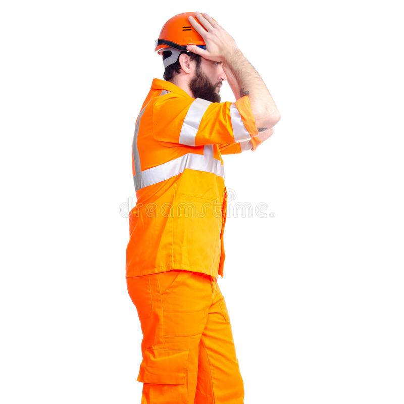 Man worker road constructor looking, hands on head stock photo
