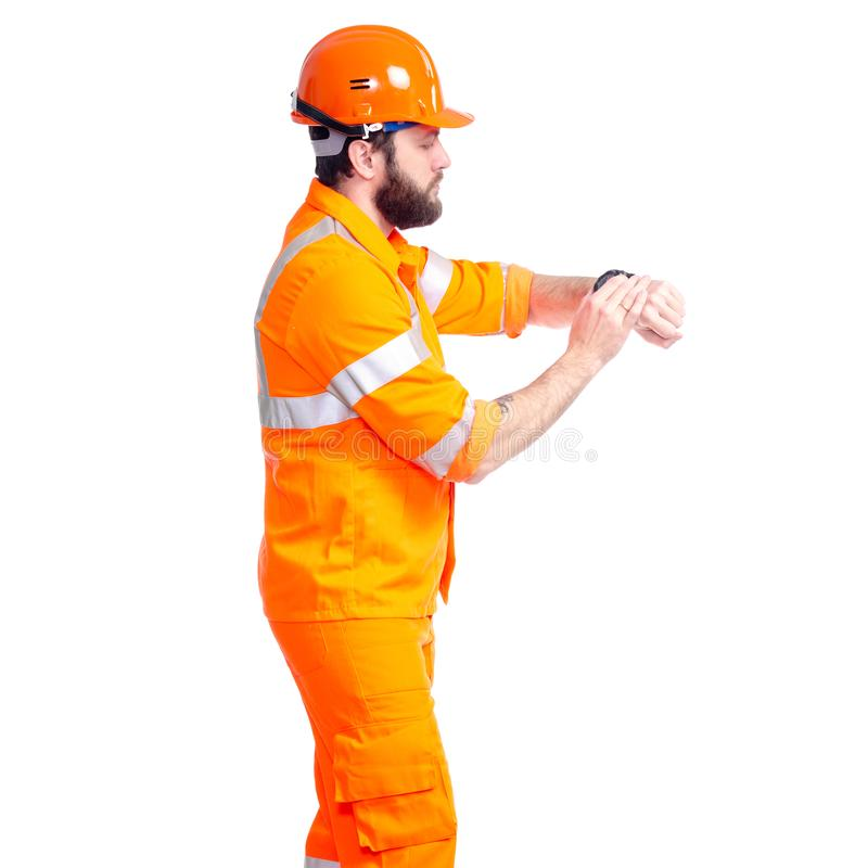 Man worker road constructor looking on watch, deadlines. On white background isolation royalty free stock images