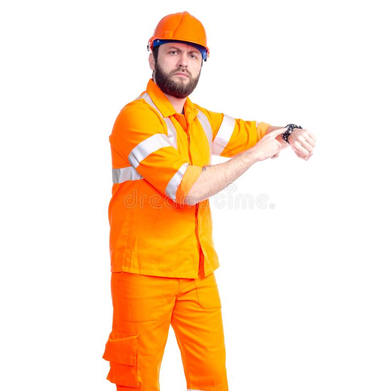 Man worker road constructor looking on watch, deadlines. On white background isolation royalty free stock photography