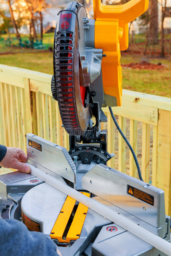 Man, worker sawing wood with a circular saw, machine for cutting. The manufacture of furniture. accessories. MDF, particle Bo stock photo