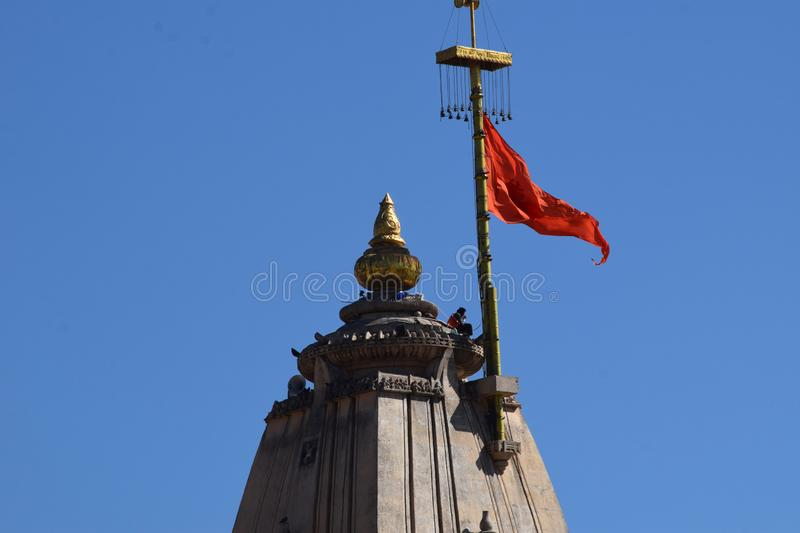 Man sitting on a big huge hindi temple top royalty free stock photography