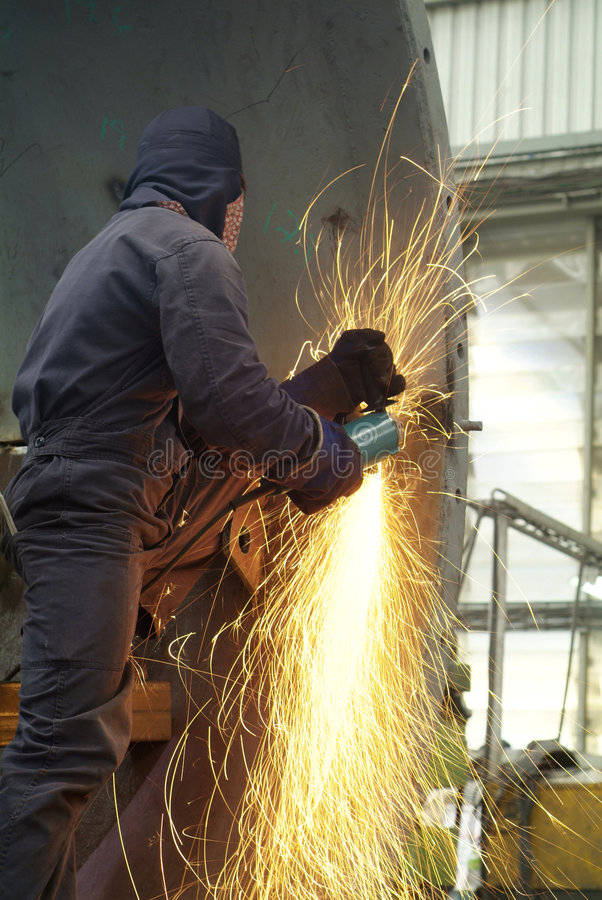 Man working with angle grinder royalty free stock image