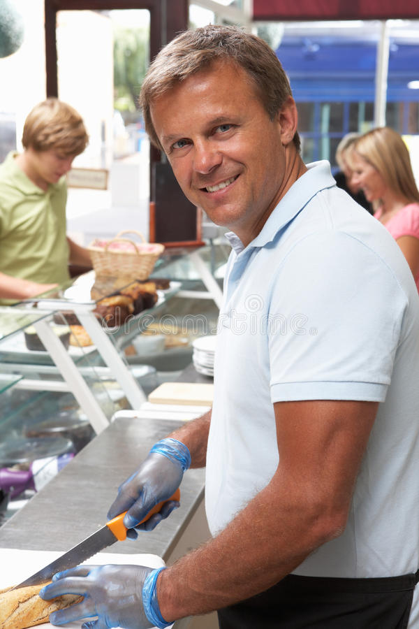 Man Working Behind Counter In Cafe Royalty Free Stock Images