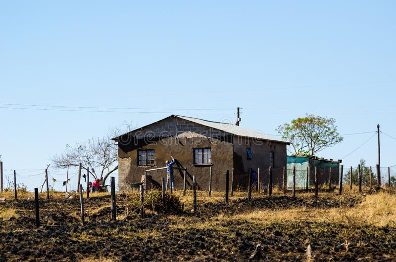 Man working building a mud house, South africa, apartheid, zululand KwaZulu-Natal. African lifestyle royalty free stock photography