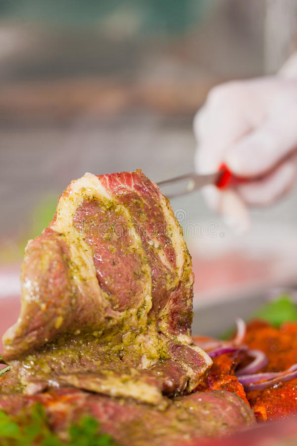 Download Man Working In Butchers Shop Showing Meat Stock Image - Image of adult, butcher: 24229697