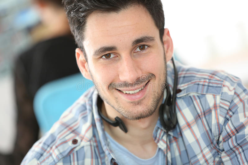 Man working in call center. Call center people in office royalty free stock image