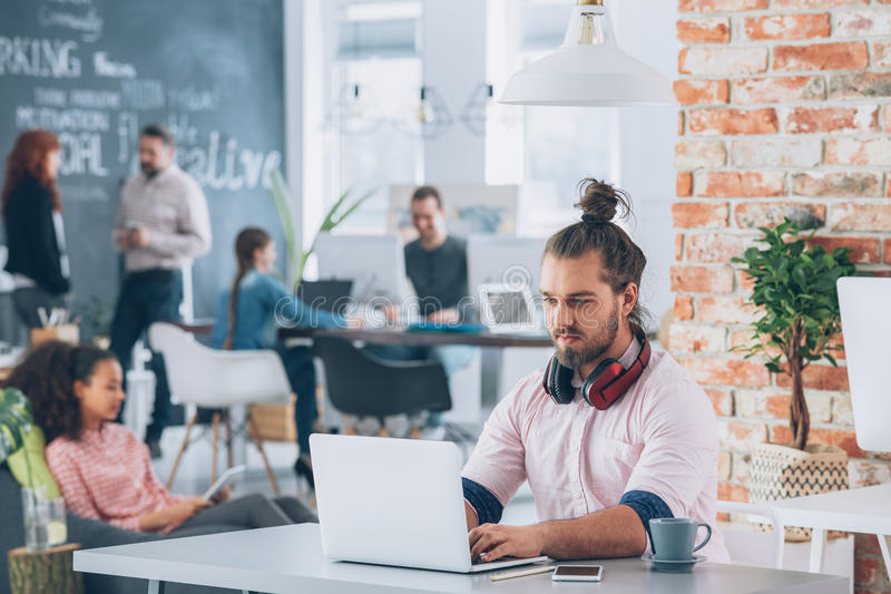 Man working in co-creative space royalty free stock image
