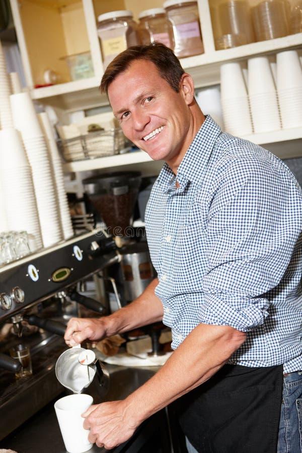 Man Working In Coffee Shop Stock Photo