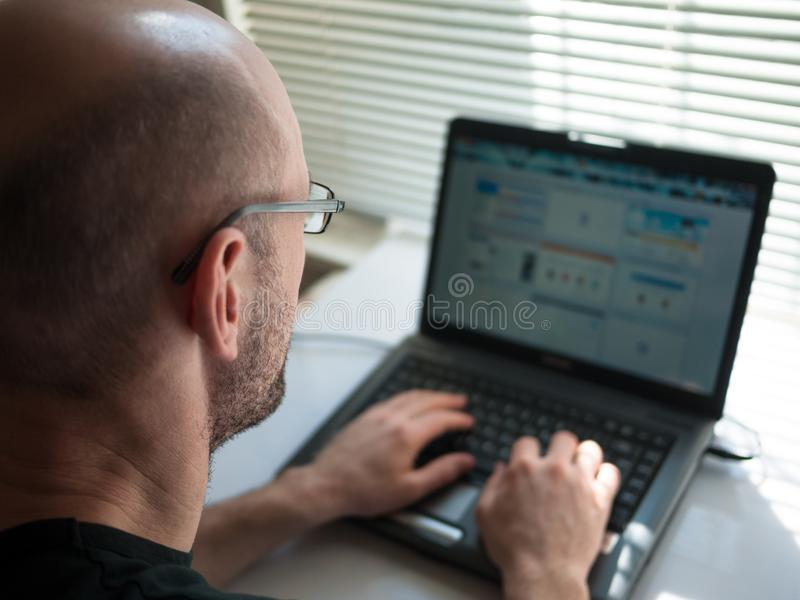 Man working on computer stock image