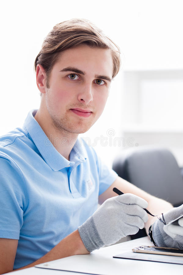 Man working with computers and electronics. stock photography