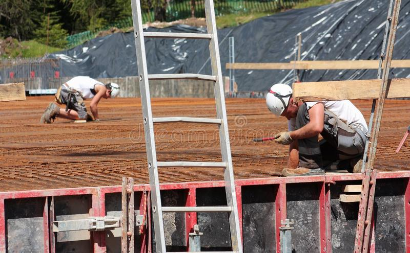 Man working in a construction site in Badia Bolzano Dolomites royalty free stock photography