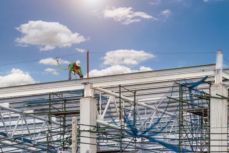 Man working on construction site with scaffold and building with sky background,scaffolding for construction factory royalty free stock images
