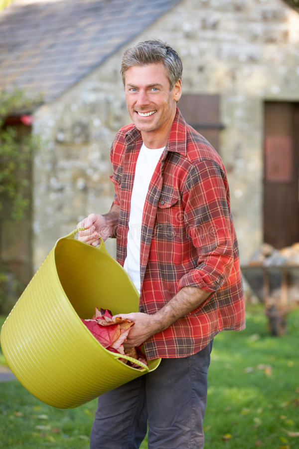 Man working in country garden. Smiling royalty free stock photography