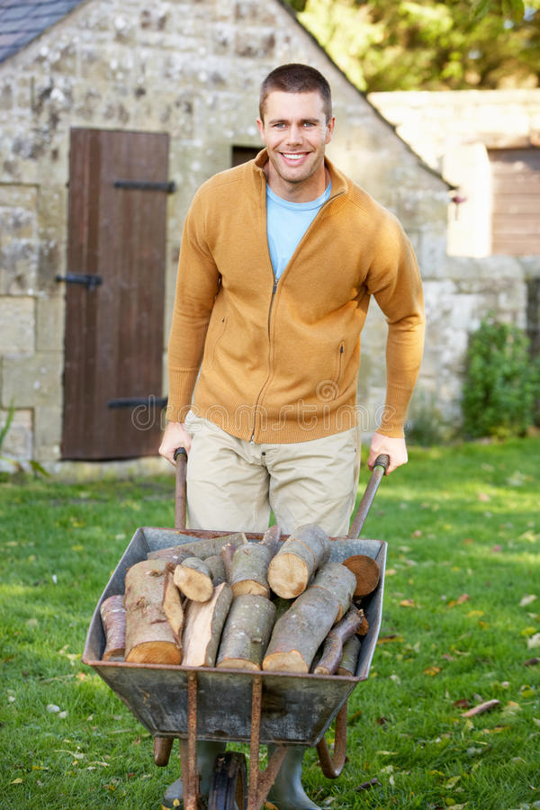 Man working in country garden. Smiling at camera stock image