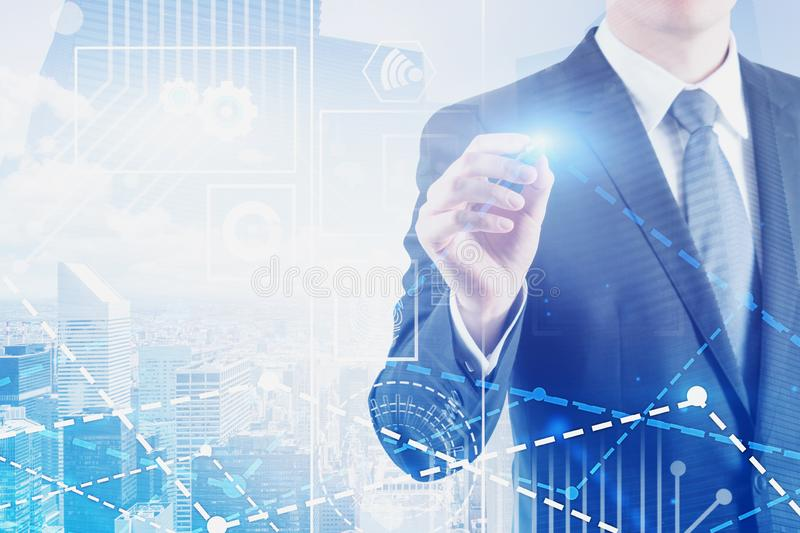 Man working with digital interface in city. Unrecognizable man in suit working with graph and digital business interface over cityscape background. Concept of hi royalty free stock photo