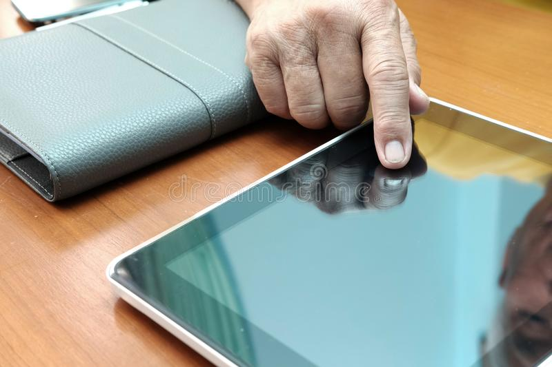 man working with digital tablet at office. hand pointing on touchpad royalty free stock image