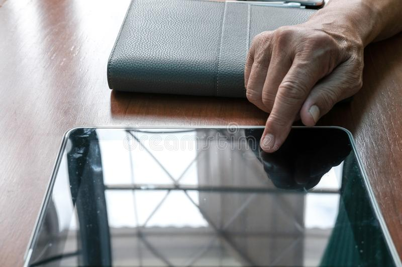 man working with digital tablet at office. hand pointing on touchpad royalty free stock photo