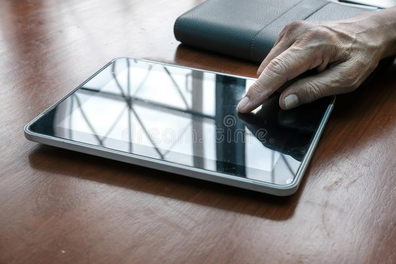 man working with digital tablet at office. hand pointing on touchpad royalty free stock images