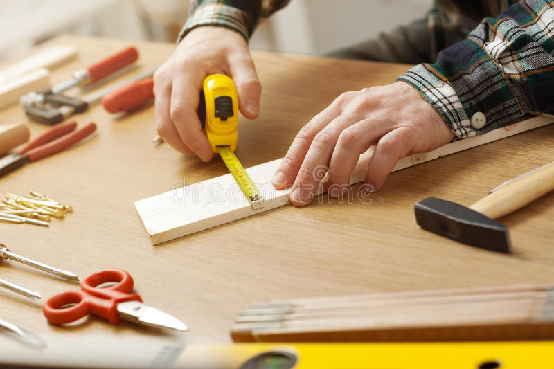 Man working on a DIY project royalty free stock images