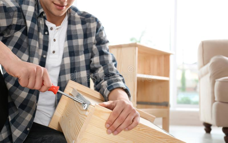 Man working with drawer indoors. Space for text stock photo